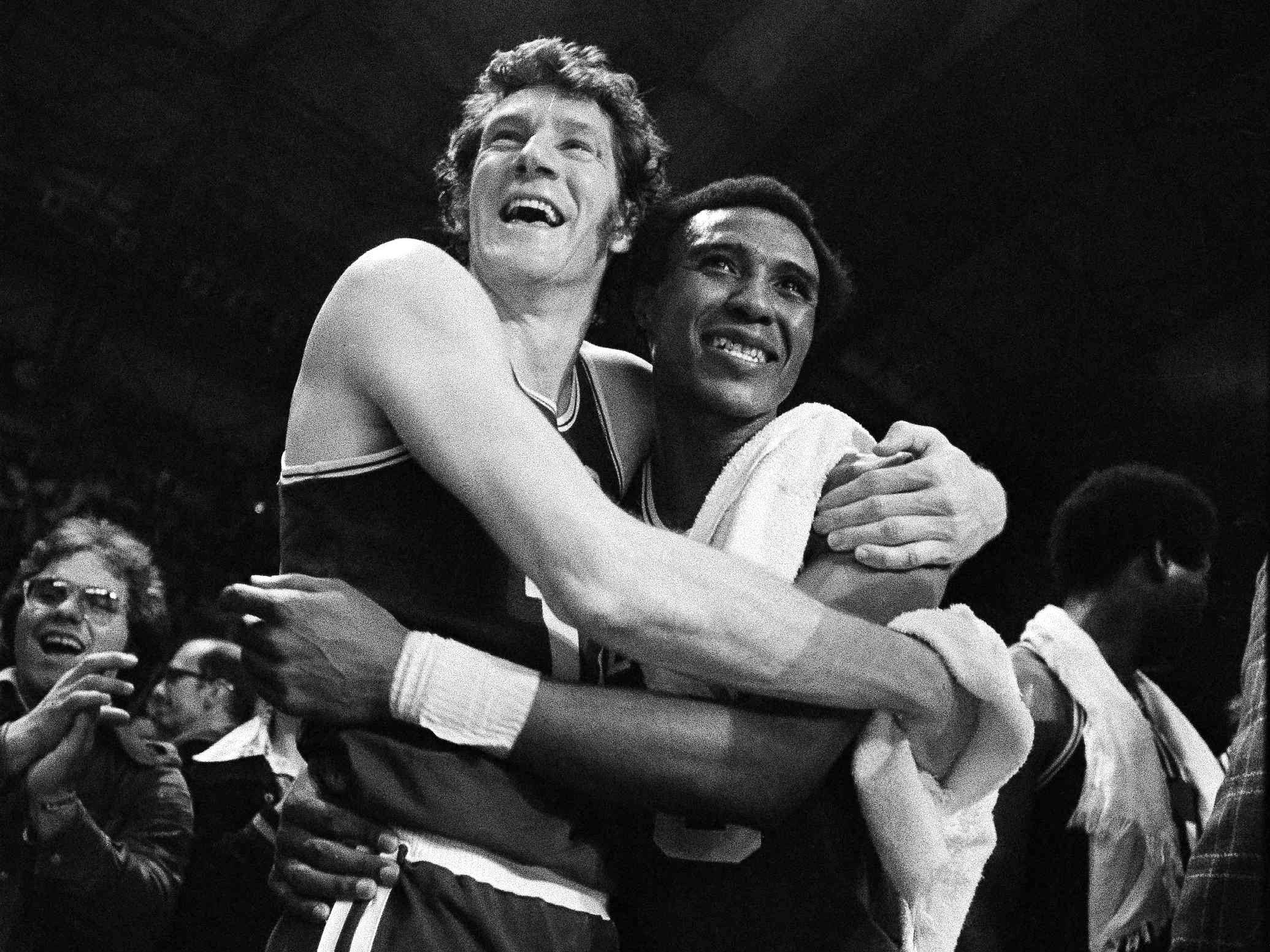 In this May 13, 1974, file photo, Boston Celtics' John Havlicek, left, and Jo-Jo White celebrate defeating the Milwaukee Bucks, 102-87 to win the NBA Championship, in Milwaukee, Wisc. The Celtics said Havlicek died Thursday, April 25, 2019, in Jupiter, Florida. He was 79. The cause of death wasn't immediately available.