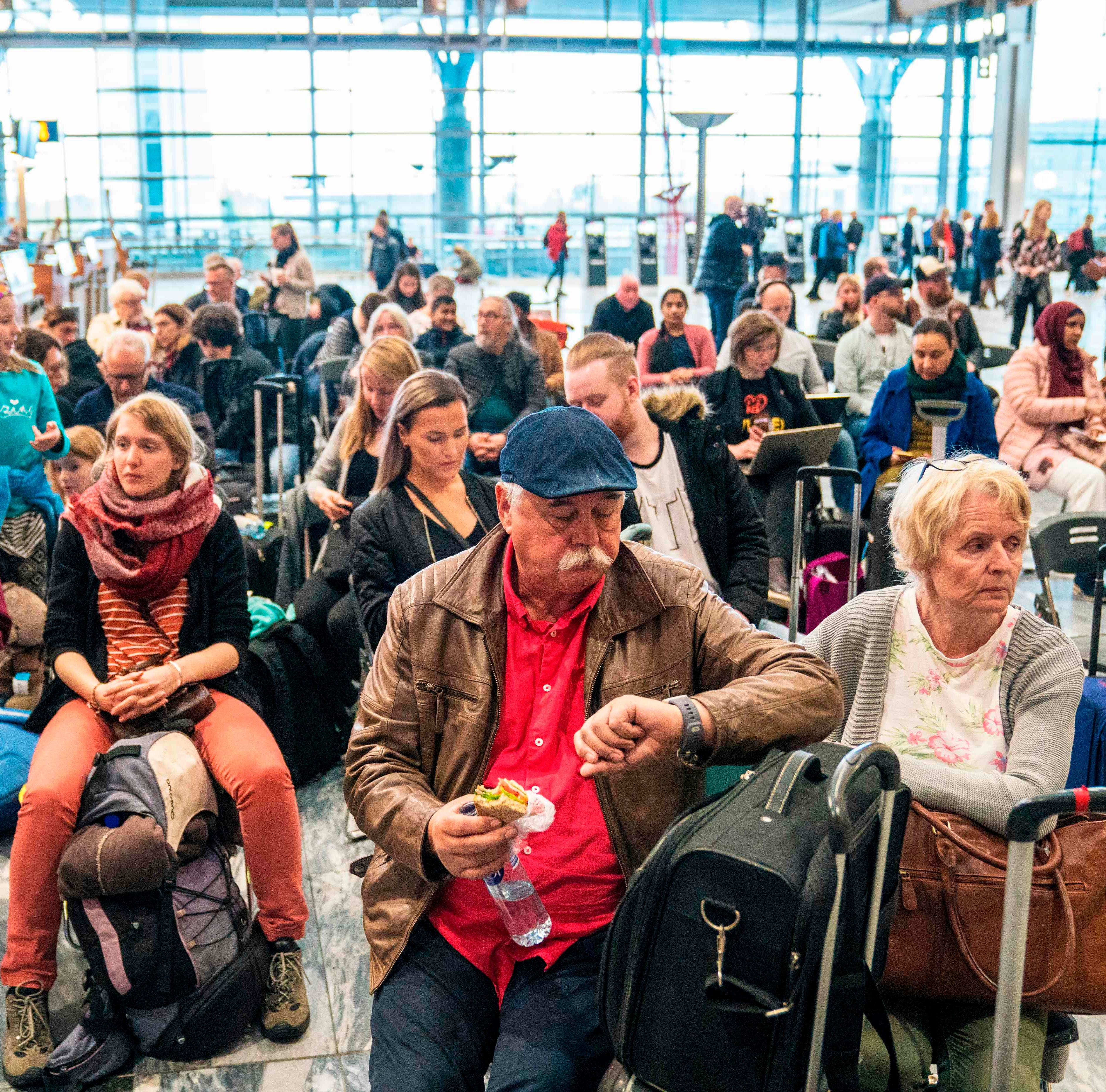 Travellers wait during a strike of Scandinavian Airlines' (SAS) pilots to contest wages and working hours on April 26, 2019 at the Gardamoen Airport in Oslo, Norway. - Pilots at SAS walked off the job in Sweden, Denmark and Norway, stranding 70,000 travellers as more than 300 flights were cancelled, the airline said. Domestic, European and long-haul flights were all affected by the strike, it  said, predicting that a total of 170,000 passengers would be affected through April 28, 2019. (Photo by Ole Berg-Rusten / NTB Scanpix / AFP) / Norway OUTOLE BERG-RUSTEN/AFP/Getty Images ORIG FILE ID: AFP_1FY2TE