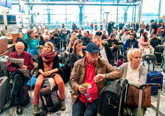 Travelers wait during a strike of Scandinavian Airlines' pilots to contest wages and working hours on April 26, 2019 at the Gardamoen Airport in Oslo, Norway.
