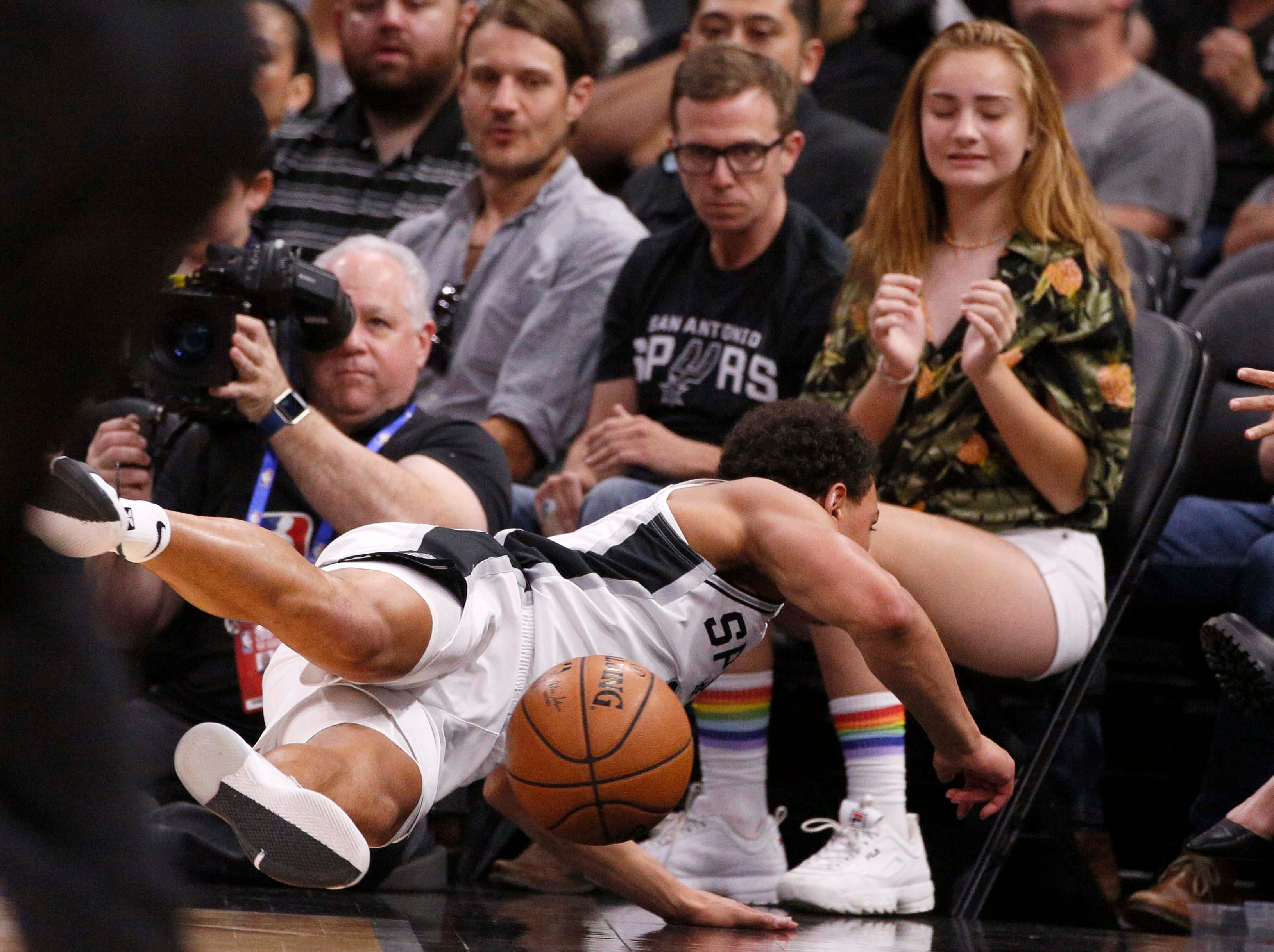 April 25: Spurs guard Bryn Forbes dives towards the courtside seats while chasing after a loose ball during Game 6 against the Nuggets.