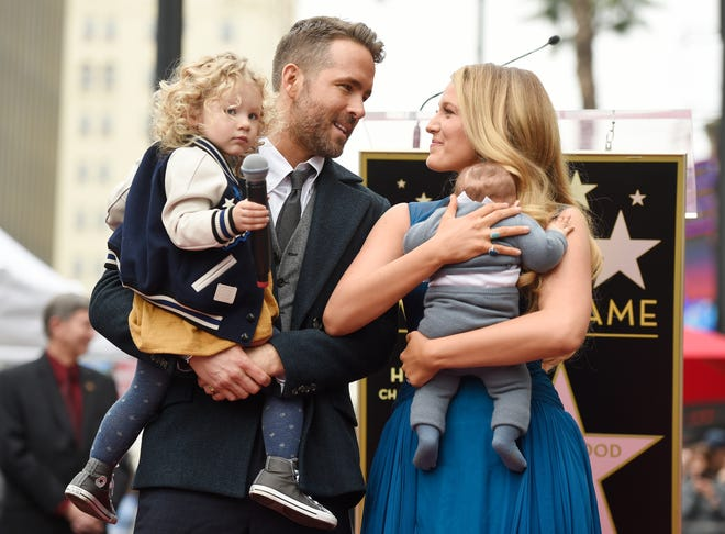 Actor Ryan Reynolds poses with his wife, actress Blake Lively, their daughter James, left, and their youngest daughter during a ceremony to award him a star on the Hollywood Walk of Fame on Thursday, Dec. 15, 2016, in Los Angeles. (Photo by Chris Pizzello/Invision/AP) ORG XMIT: CACP103