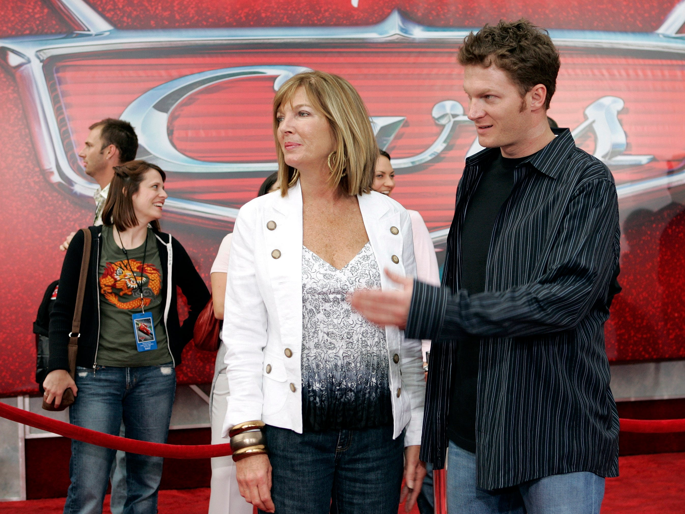 """In this May 26, 2006, file photo, NASCAR driver Dale Earnhardt Jr., right, and his mother Brenda Jackson, front left, arrive for the premiere of the Disney/Pixar animated film """"Cars"""" at Lowe's Motor Speedway in Concord, N.C. Jackson, a longtime employee at JR Motorsports, has died following a battle with cancer. She was 65. The team announced her death Monday, April 22, 2019."""