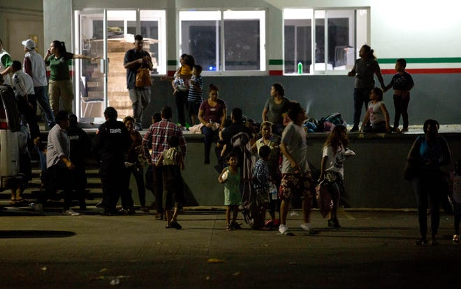 Migrants waits for their transfer from an immigration detention center in Tapachula, Chiapas state, Mexico, Thursday, April 25, 2019. A large group of mainly Cuban migrants escaped on foot from the immigration detention center on Mexico's southern border in the largest mass escape in recent memory. Later, about half of the group returned voluntarily.