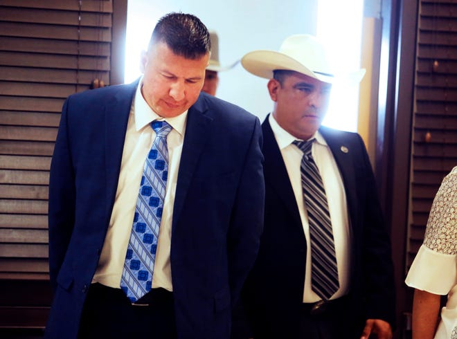 """Edinburg Mayor Richard Molina walks into the courtroom before being arraigned by  Justice of the Peace Precinct 2 Jaime """"Jerry"""" Muñoz on charges of trying to rig his own 2017 election victory, Thursday, April 25, 2019, in Pharr, Texas."""