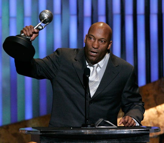 "After a statement on behalf of John Singleton's family said the ""Boyz N the Hood"" director was in a coma, his daughter responded otherwise."
