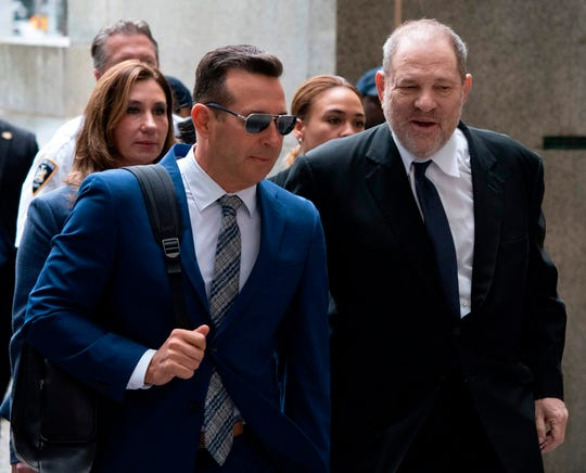 Fallen movie mogul Harvey Weinstein and his celebrity lawyer, Jose Baez, arrive at court on April 26, 2019 in New York, for a pre-trial hearing over sexual assault charges against him.