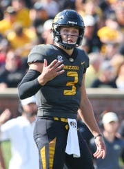 Missouri Tigers quarterback Drew Lock (3) looks to the sideline against the Purdue Boilermakers in the second half at Faurot Field.