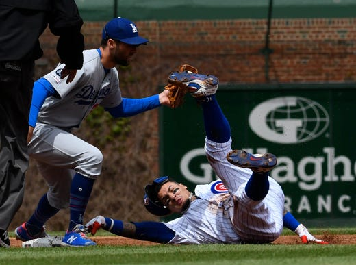 April 25: The Chicago Cubs' Javier Baez is tagged out at second base on a stolen base attempt by Los Angeles Dodgers shortstop  Chris Taylor (3) during the first inning at Wrigley Field. The Dodgers won the game, 2-1.