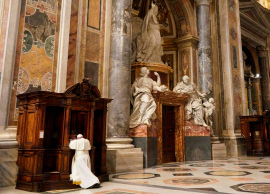 Pope Francis kneels before a priest to confess during a penitential liturgy mass on the Friday of the Third Week of Lent, on March 29, 2019 at St. Peters Basilica in the Vatican.