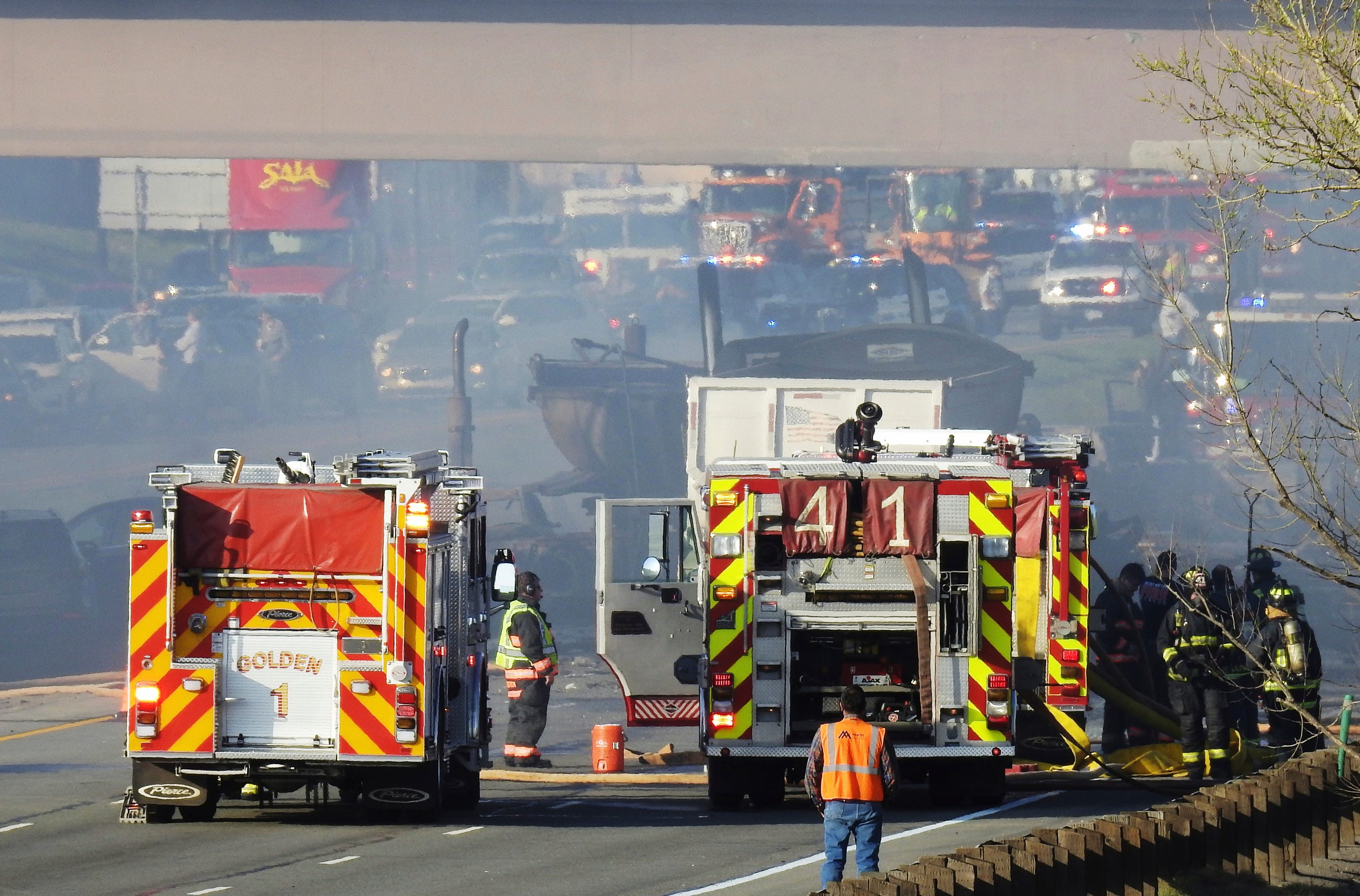 Emergency crews work at the scene of a deadly collision on Interstate 70 near the Colorado Mills Parkway in Lakewood, Colo.  April 25, 2019.