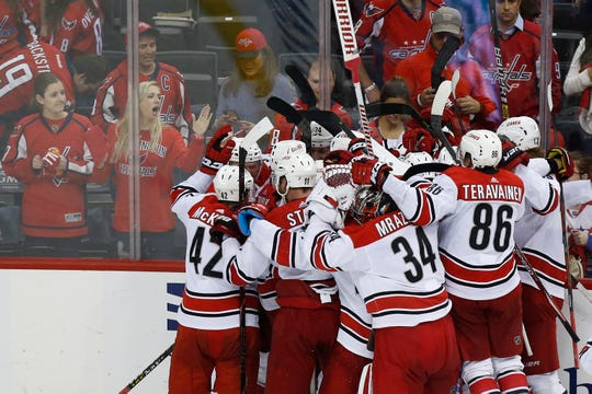 Hurricanes players celebrate winning Game 7 of their first-round series against the Capitals.