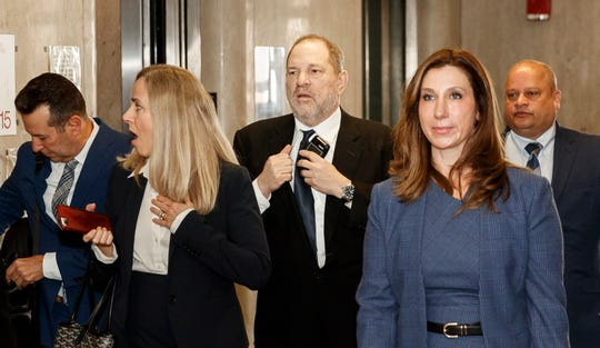 Harvey Weinstein, accompanied by members of his new legal team, arrives for a pretrial hearing related to his upcoming trial on sex-crime charges in New York, April 26, 2019.