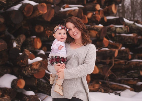 Sarah Buckley Friedburg with her daughter. The mom shared a viral post about what society tells working moms.