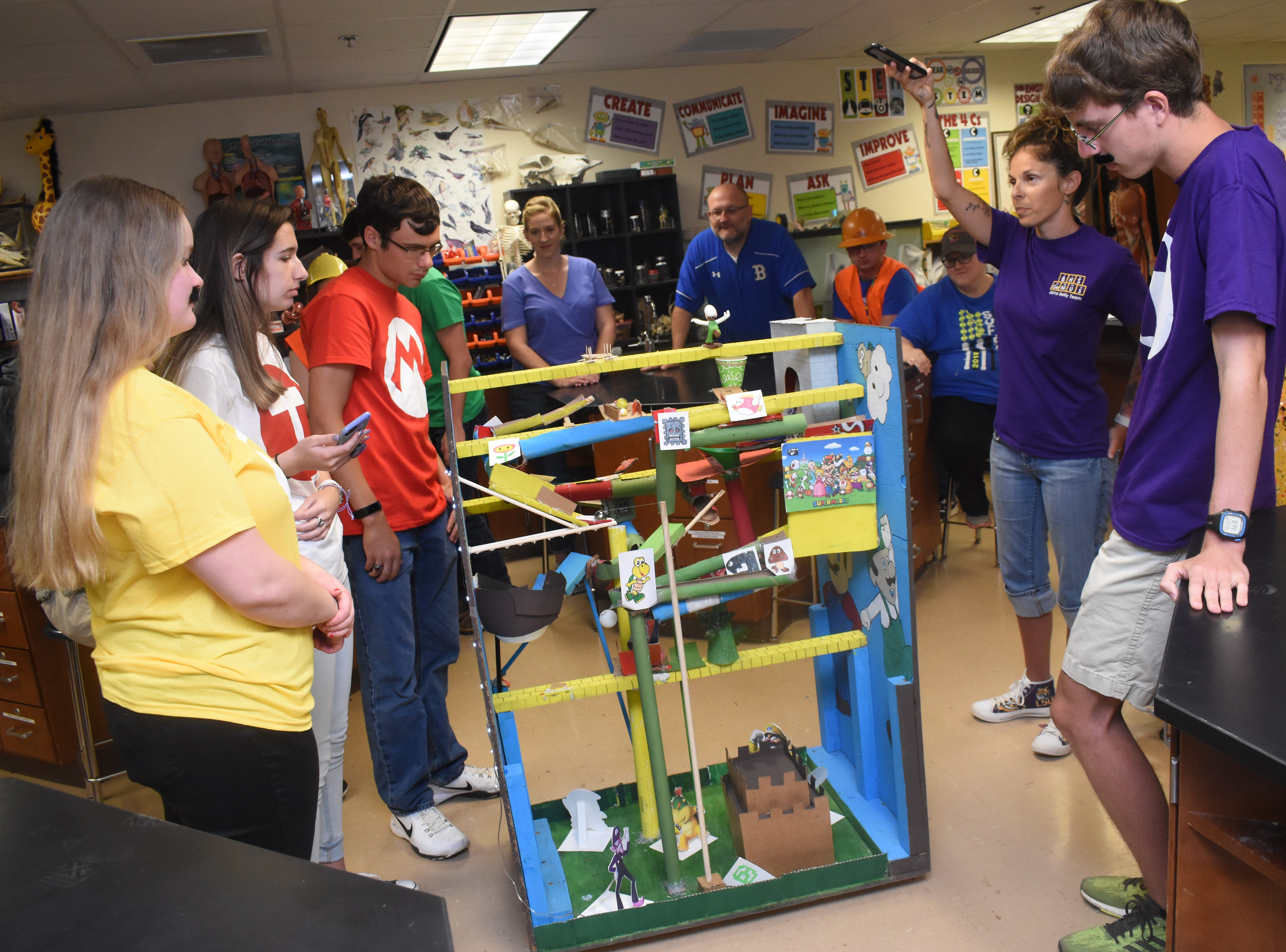 Buckeye High School students in Lacey Hoosier's science class apply S.T.E.M. principles (Science. Technology. Engineering. Math.) in creating Rube Goldberg machines. The Website www.rubegoldberg.com says Rube Goldberg machines are machines designed to do simple tasks in a complex manner. For example, a simple task for one of the groups in the class was getting the machine to put an Alka-Seltzer tablet in a cup of water. The machines were designed by inventor and cartoonist Rube Goldberg.