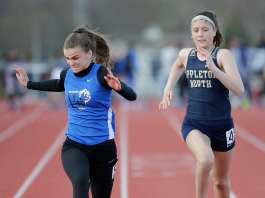 Oshkosh West's Megan Best, left, competes against Appleton North's Kalea Weyenberg in the 100 dash final at the Neenah co-ed invitational track and field meet on April 26.
