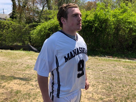 Manasquan's Canyon Birch talks to the media after setting the state scoring record on April 27 at Manasquan High School