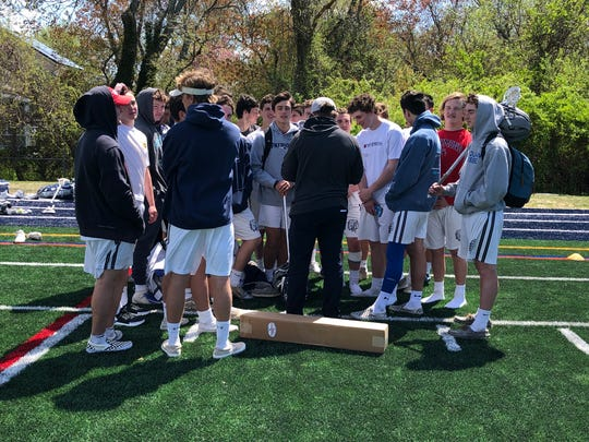 Manasquan coach Sean Cunningham (center) talks with the Warriors following the team's 13-2 over Rumson-Fair Haven on April 27.
