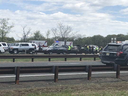 Garden State Parkway crash in Holmdel leaves all lanes blocked, cars mangled. First responders at the scene.