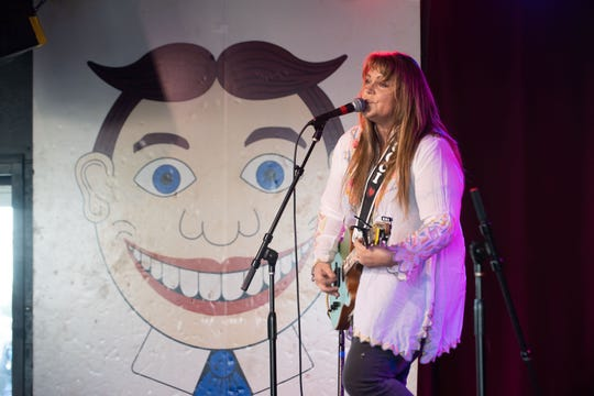 Christine Martucci on stage for Jersey Storytellers Project 'Pride in the Arts' at the Wonder Bar during the Asbury Park Music & Film Festival.