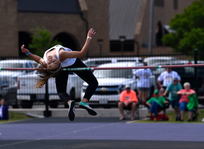 Trinity Tomlinson of Early competes in the girls high jump during Saturday's Region 1-3A track meet at Abilene Christian University. The defending state champion cleared 5 feet, 7 inches to tie with two other competitors but won on fewer misses.
