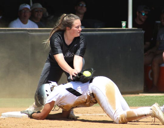 Arlington High third baseman Paige Phillips look toward the ump but does not get the call as an Abilene High baserunner safely advances during Saturday's Class 6A bi-district softball game at the Abilene ballpark. The Lady Eagles won 18-0.
