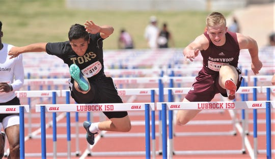 Brownwood's Tommy Bowden, right, battles Lamesa's James Rodriguez in the boys 110-meter hurdles. Bowden won the race in 14.73, while Rodriguez was second (14.76).