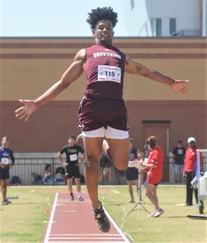 Brownwood's A.J. McCarty sails the through air in the boys long jump. The junior won the event with a 22-81/2 at the Region I-4A track and field meet Saturday, April 27, 2019, at Lowrey Field in Lubbock.