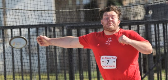Cooper's McCord Whitaker lets the discus fly.