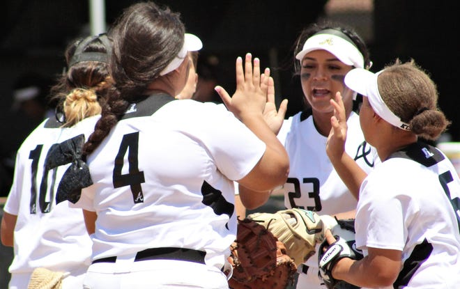 Abilene High softball players Kaylen Washington (10), Sydnee Killam (4), K.C. Walker (6) and Alyssa Washington (23) five it up before the start of Saturday's Class 6A bi-district softball game against Arlington High. Abilene won, 18-0, to take the series.  April 27, 2019.