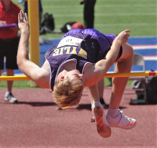 Wylie's Stran Blair tries to get over the bar at 6 feet, 2 inches. He missed all thre attempts and finished seventh at 6-0 at the Region I-5A track and field meet Saturday, April 27, 2019, at Lowrey Field in Lubbock.
