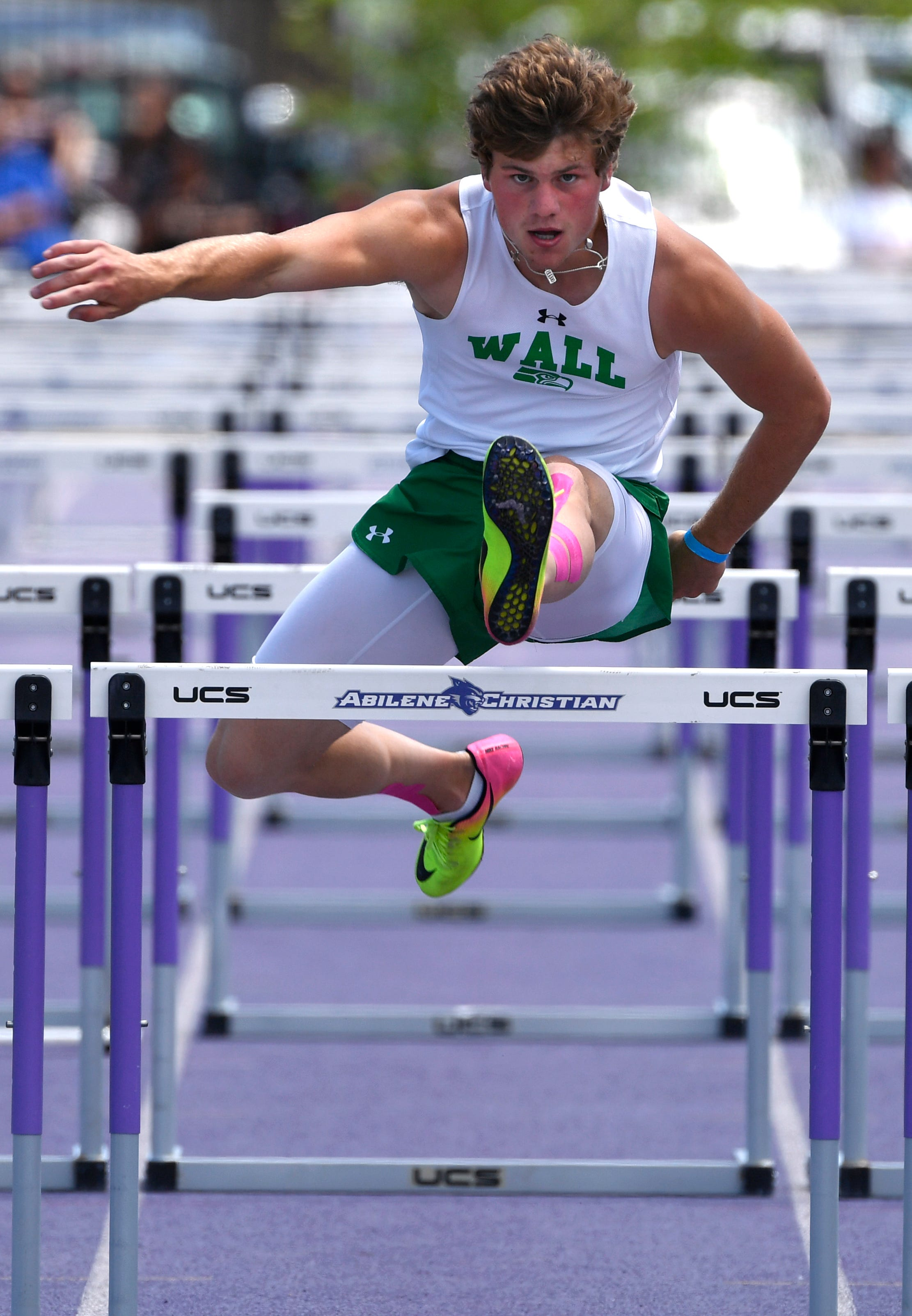 Wall's Drake Holifield competes during the 110 hurdles during the Region I-3A track meet at Abilene Christian University on Saturday, April 27, 2019.