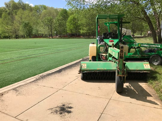 The nonprofit that runs the JBL Soccer Complex said having cleanup equipment on hand, such as this brush machine, makes it possible to clean up flood silt within a few weeks.
