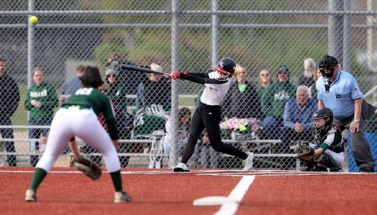 Olympic's Molly Gates hits a home run in a game against Port Angeles at the Kitsap County Fairgrounds. The Trojans are averaging 12.5 runs in Olympic League 2A play this season.