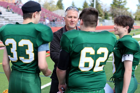 South Kitsap football coach Dan Ericson speaks with eighth-grade football players from Marcus Whitman Middle School during a signing ceremony Saturday at Kitsap Bank Stadium.