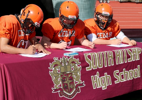 Eighth-grade football players from Cedar Heights Middle School in Port Orchard sign letters of intent to play at South Kitsap High School during the 2019-20 school year.