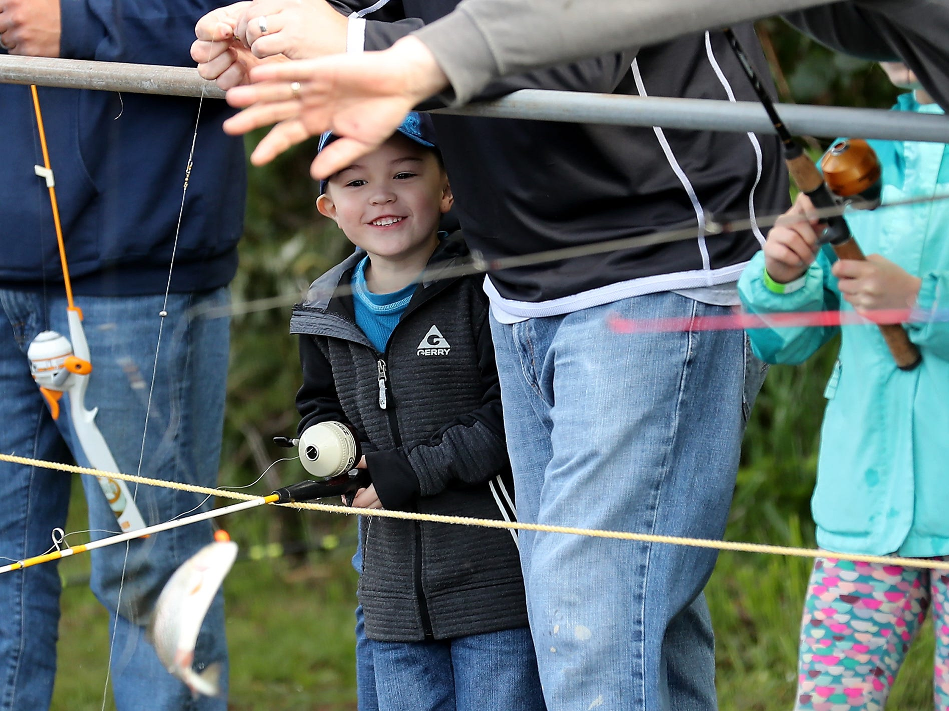 Kitsap Poggie Club hosts their 71st. Annual Kids Fishing Party at the Jarstad Park Hatchery in Gorst on Saturday, April 27, 2019.
