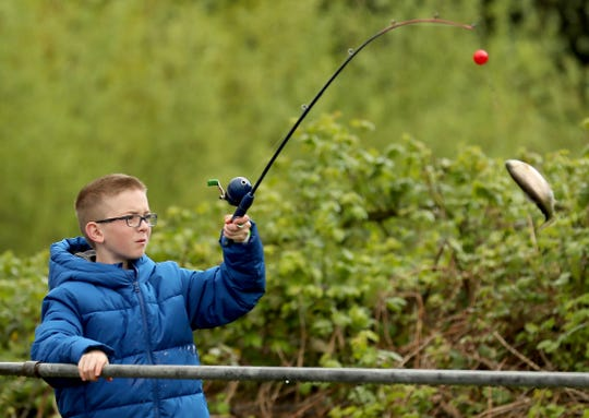 Dylan Phillips, 11, reels in his first trout of the day during the Kids Fishing Party at the Jarstad Park Hatchery in Gorst on Saturday, April 27, 2019.