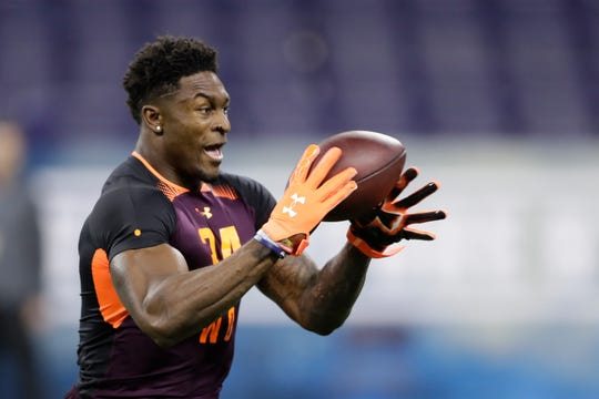 Mississippi wide receiver D.K. Metcalf runs a drill during the NFL football scouting combine, Saturday, March 2, 2019, in Indianapolis. (AP Photo/Darron Cummings)