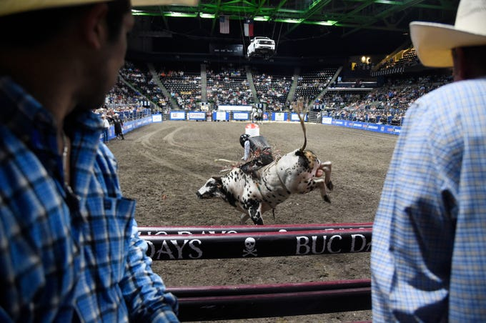 Stetson Wright bull rides during the Corpus Christi rodeo, Friday, April 26, 2019, at the American Bank Center.