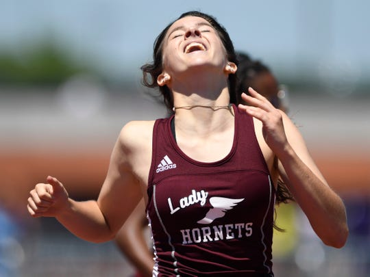 Flour Bluff's April Polansky celebrates after placing first in the women's 300 meter hurdles during the second day of Region IV-5A track meet, Saturday, April 27, 2019, at Heroes Stadium in San Antonio.