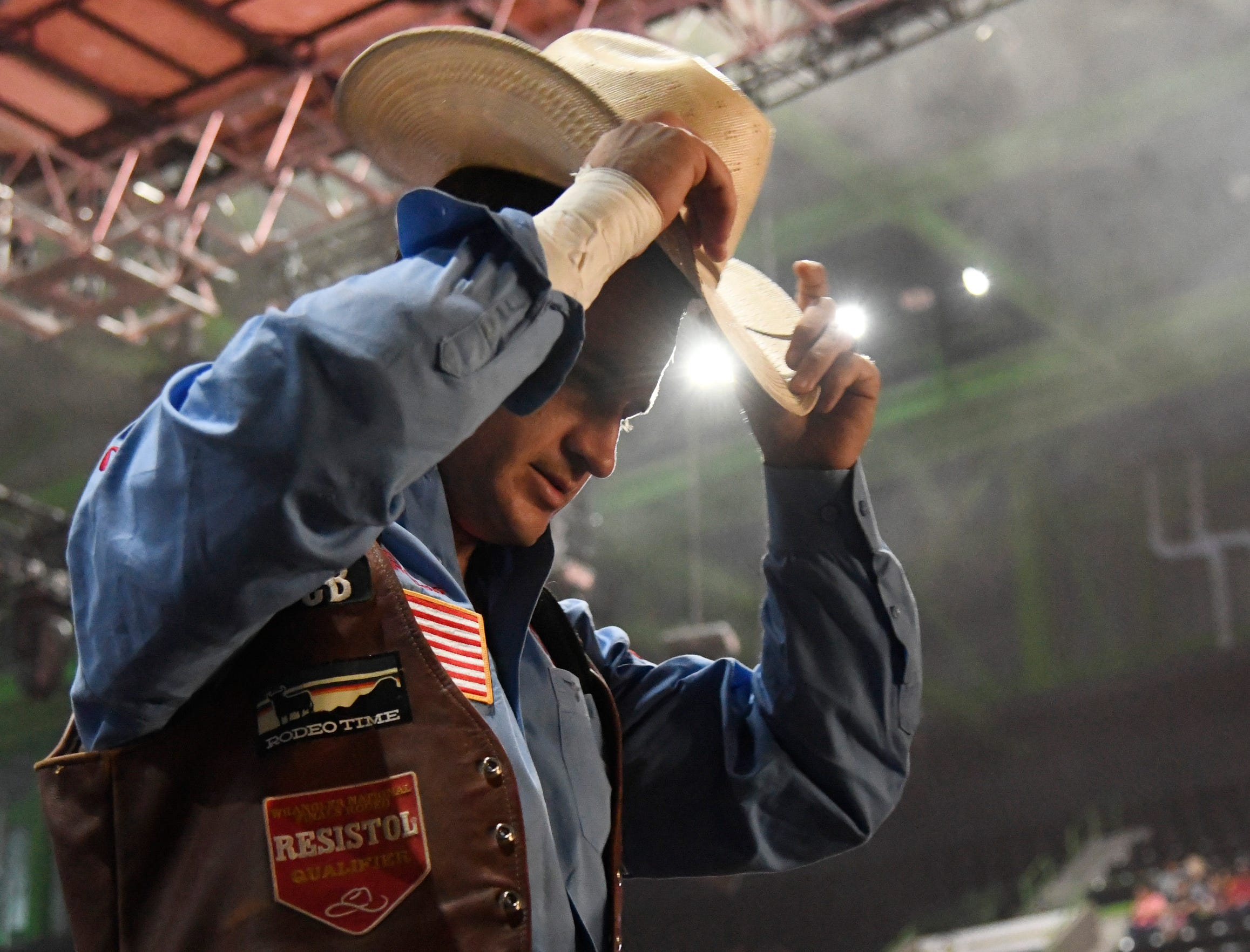 Jake Brown adjusts his hat before bareback riding at the Corpus Christi rodeo, Friday, April 26, 2019, at the American Bank Center.