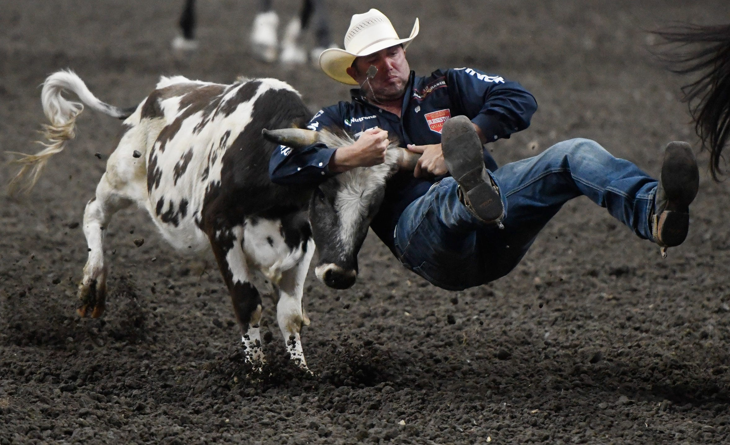 Denver Berry wrestles a steer during the Corpus Christi rodeo, Friday, April 26, 2019, at the American Bank Center.