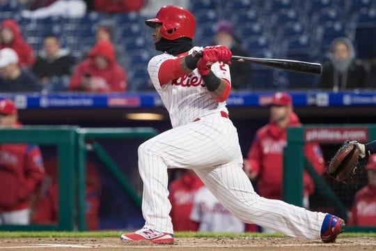 Apr 5, 2019; Philadelphia, PA, USA; Philadelphia Phillies shortstop Jean Segura (2) hits an RBI double during the first inning against the Minnesota Twins at Citizens Bank Park. Mandatory Credit: Bill Streicher-USA TODAY Sports