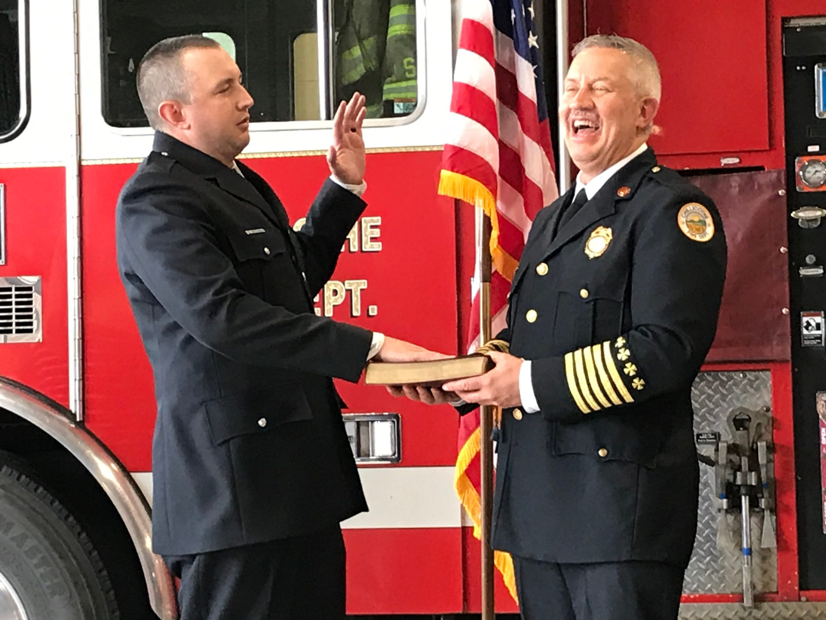 Chillicothe Fire Chief Jeff Creed laughs after Chillicothe Public Safety Director Jeff Carman (not pictured) gives new fire Lt. Nick Mathias a bit too much to repeat at once during Mathias' promotional swearing in on Friday, April 26, 2019.