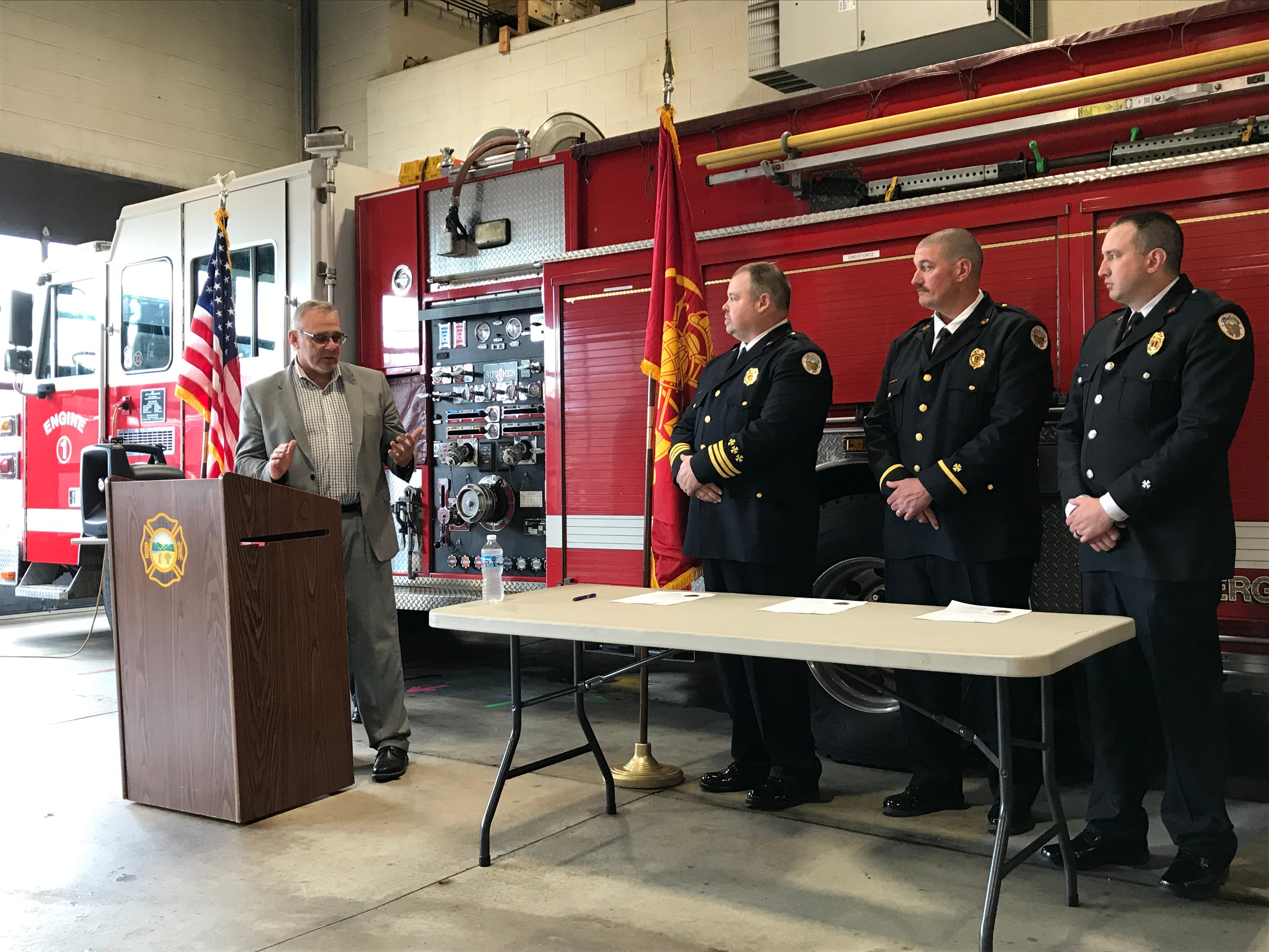 Chillicothe Public Safety Director Jeff Carman (left) offers a few words of advice for the Chillicothe Fire Department's newly promoted leadership (left to right) Assistant Fire Chief Aaron Knotts, Capt. Ryan Wade, and Lt. Nick Mathias.