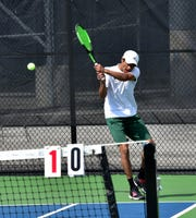 Niraj Komatineni of Mason powers back a forehand return in the Flight A  first singles at the 2019 GCTCA Coaches Classic Tennis Tournament, April 26, 2019