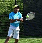 Manav Midha of Cincinnati Country Day grimaces on a forehand return in the Flight A  first singles at the 2019 GCTCA Coaches Classic Tennis Tournament, April 26, 2019
