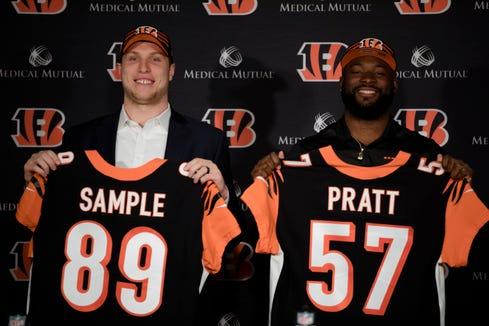 From left, Bengals tide end Drew Sample, 2nd round draft pick from the University of Washington, and Bengals linebacker Germaine Pratt, from 3rd round draft pick from North Carolina State University, hold their jerseys during a press conference on Saturday, April 27, 2019, at Paul Brown Stadium in Cincinnati.