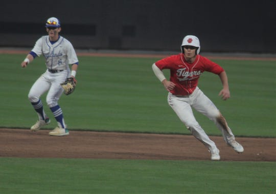 Beechwood senior Logan Castleman leads off second as Beechwood faced off with Highlands in baseball as part of the Reds Futures Showcase at Great American Ball Park, April 26, 2019.