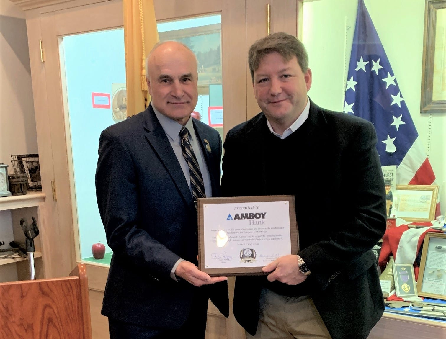 Gregory Scharpf, Amboy Bank president and CEO, is presented a plaque by Old Bridge Mayor, Owen Henry, for the bank's 130 years of service in the community. Mayor Henry hosted an opening ceremony for the township's 150th anniversary, where he presented a mayoral proclamation, and Richard Pucciarelli, vice presidentof the Madison Township-Old Bridge Historical Society, provided a brief history on the Township's history. The event kicked off the yearlong celebration.